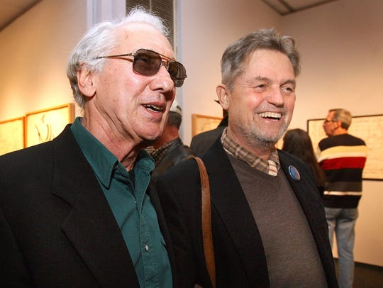 Tallahassee artist Jim Roche, left, and his friend,