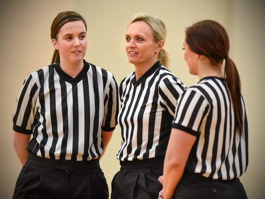 Officials Amanda Tate, Haley Johnson and Sandy Engdahl