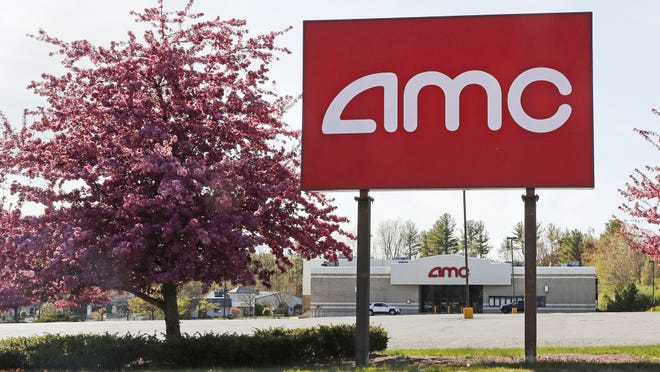 A May 14 photo at an AMC theater in Londonderry, N.H. After three months of near total blackout of cinemas nationwide, movie theaters are preparing to reopen - even if it means only a few titles on the marquee and showings limited to as little as 25% capacity.