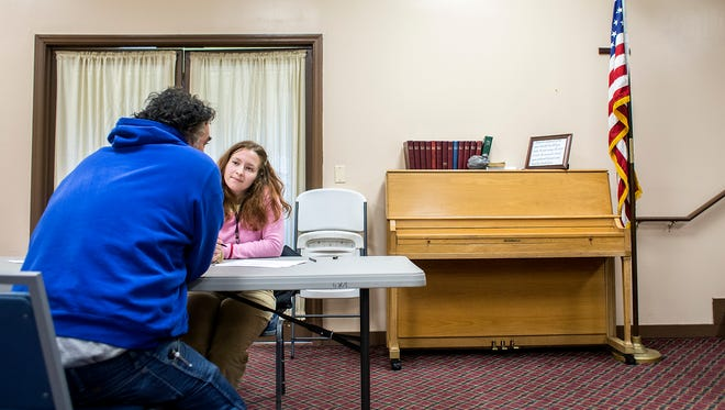 Lauren Zaloshinsky, right, interviews Richard Chavis, a homeless man, during the annual Point-In-Time Count at the Veterans Restoration Quarters Wednesday.