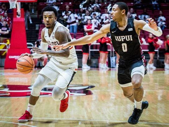Ball State's Jontrell Walker drives against IUPUI on Saturday, Dec. 2, 2017.
