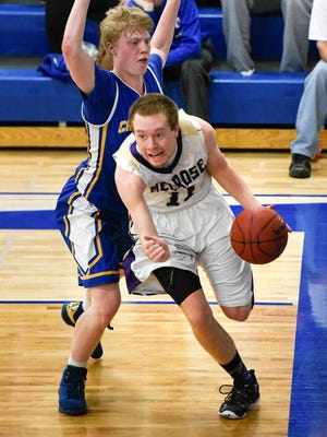 Melrose's Dillon Haider takes the ball past St. Cloud Cathedral's William Kranz during the first half Tuesday, Jan. 17 at Cathedral High School. Haider is the Times Media Prep Athlete of the Week.