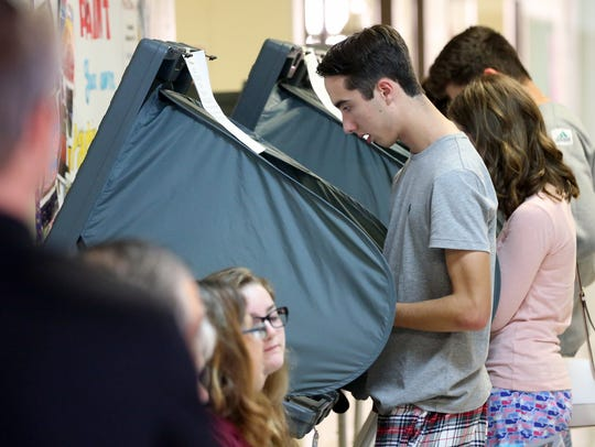 Cormac Henderson casts his vote for the 2016 election