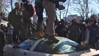 Philadelphia police seek suspects who trashed parade-goer's Corvette