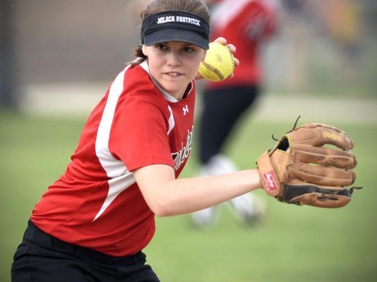 Milaca's Rachel Airhart fires a throw to first base