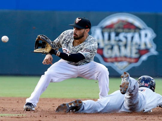 Chihuahuas second baseman Carlso Asuaje looks the ball into his glove during a steal attempt by Colorado Springs right fielder Brett Phillips, Phillips got the jump and made it safely to second base.