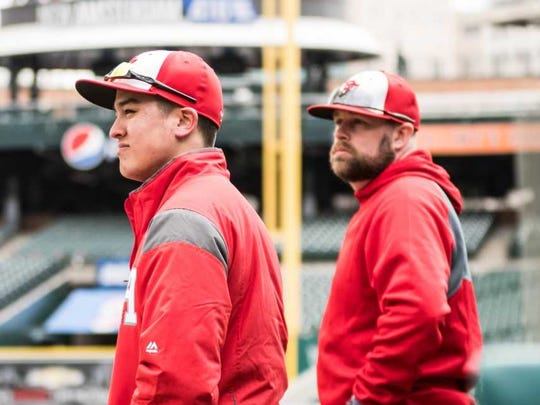 Port Huron coach Kyle Sheppard (right) takes a look onto the Comerica Park field