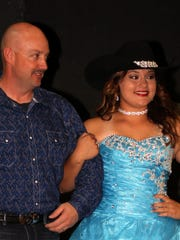 Fair queen contestant Kyleen Darian Hensley was the belle of the ball in this stunning evening gown. She is escorted by her father, Kevin Hensley.