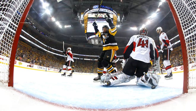 Pittsburgh's Nick Bonino celebrates a goal scored by teammate Olli Maatta during the first period of Sunday's Eastern Conference Finals game.
