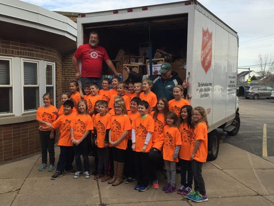 """Fourth-grade students in Alisia Myers' class at Lakeview Elementary School in Neenah organized a school-wide contest called """"Stuff The Turkey"""" to see which class could donate the most items. As a school, Lakeview donated twice the amount it had in previous years with more than 2,800 items, equaling 2,500 pounds donated to Salvation Army."""