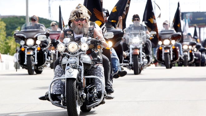 Harley-Davidson riders start their engines at the beginning of the parade at the 110th anniversary celebration in 2013. The 115th anniversary parade is Sept. 2.