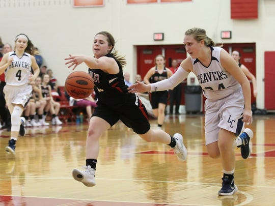 Lebanon Catholic senior Allison Warren and Tri-Valley's Alyssa Connell go after a loose ball during Lebanon Catholic's 47-30 over Tri-Valley in the PIAA Class A tournament second round at Hamburg Area High School on Wednesday.