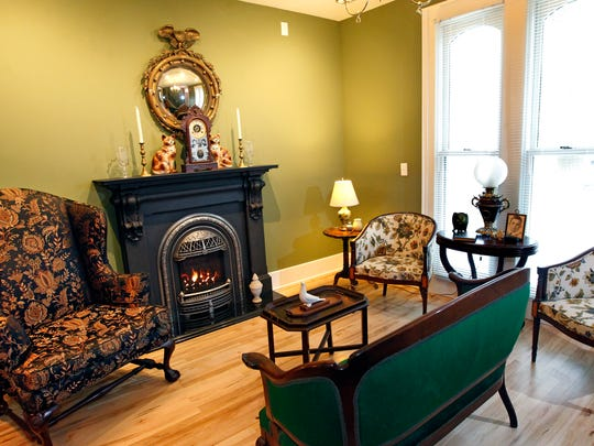 A major feature of the living is the new cast-iron gas fireplace that was made to look like a period piece.