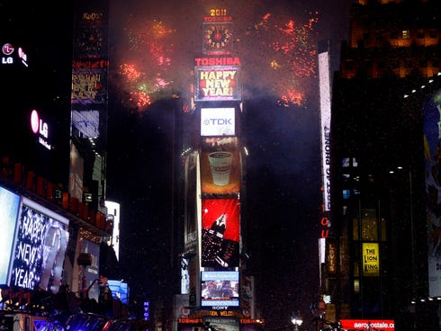 Fireworks as they erupt from a building to signal the New Year, 2011,  in Times Square in New York.