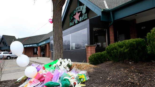 A small memorial for Srinivas Kuchibhotla is displayed outside Austins Bar and Grill in Olathe, Kan., on Feb. 24, 2017.