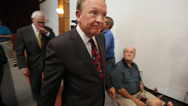University of Louisville Interim President Greg Postel approaches a podium just before he announced that athletic director Tom Jurich and men's basketball coach Rick Pitino have been placed on administrative leave from the school.  