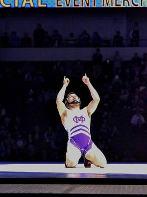 Mission Oak's Jaden Enriquez celebrates after winning the state title at 138 pounds on Saturday at the 45th annual CIF Boys Wrestling State Championships at Rabobank Arena in Bakersfield. He defeated Rancho Buena Vista's Bernie Truax by a 16-6 major decision in the final.