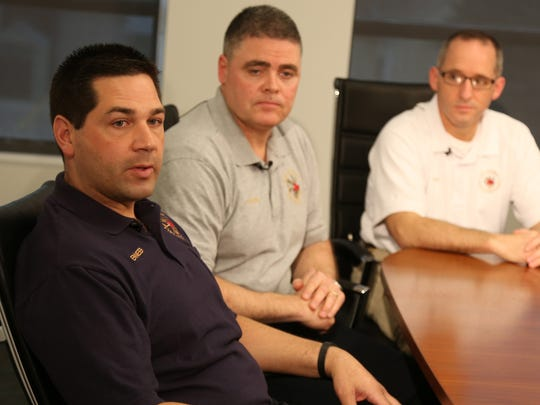From left, Des Moines firefighter Mike Flaherty, Capt. Kerry Schnieder and Fire Chief John TeKippe recall their experiences the night of the fire.