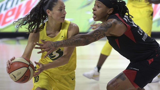 Seattle Storm guard Sue Bird (10) is defended by Las Vegas Aces forward Emma Cannon (32) Sunday in Bradenton, Fla.