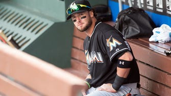 Miami Marlins catcher Jarrod Saltalamacchia (39) sits in the dugout before a game against the Philadelphia Phillies at Citizens Bank Park in Philadelphia on April 23, 2015.