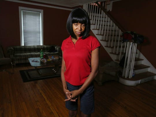 Roslyn Johnson, 46, bought her house in Detroit nearly three years ago and is under a deadline to pay about $15,000 in back property taxes. She did not know the property was behind on taxes when she purchased the house.