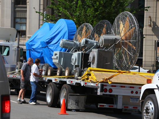 """Crews unwrap giant fans on Lafayette near Shelby prior to afternoon shooting. Filming for the superhero movie """"Batman v. Superman: Dawn of Justice"""" took place in downtown Detroit on Saturday, Aug. 9, 2014. """"Batman v. Superman"""" was given the OK for $35 million in incentives on an anticipated $131 million in Michigan spending."""