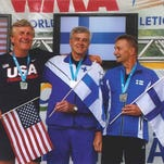 Pictured are (L-R) Ed Hearn, second place, United States; Teuvo Kemppainen, first place, Finland; and Hannu Kortesluoma, third place, Finland.