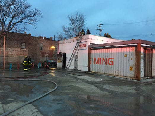 Firefighters on the scene at Katoi restaurant in Detroit's