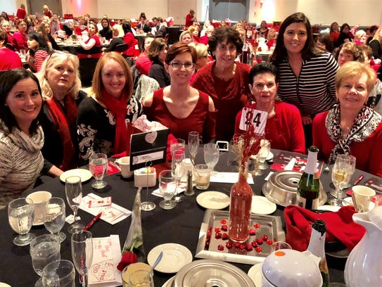 GO RED – Go Red For Women celebrated its 5th Birthday, with a sold out crowd of 480 guests. The 5th Annual Luncheon raised almost $125,000 to fund advocacy, education and research to fight all women's and our nation's No. 1 risk of death, cardiovascular disease. Guests brightly attired in red gave the room an incredible glow, outshone only by the beautiful purses available for silent auction bidding. Sitting at the Vanderburgh Medical Alliance table are Francie Renschler, Cindy Behrens, Diane Marret, Heidi Lance, Marty Vibul, Fran Vix, Tori Pugh and Jolene Meyers. This event supported the American Heart Association.