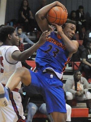 Southwood's Latreavin Black pulls down a rebound against Evangel recently.