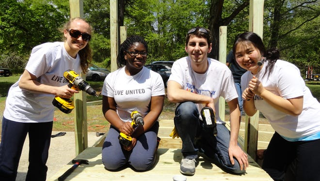 Salisbury University's Student United Way recently teamed up with Chesapeake Housing Mission to help build a wheelchair ramp for a community member in need. From left are, Amanda Brady, Sylvia Aklikokou, Kyle Eskridge and Se Hong.