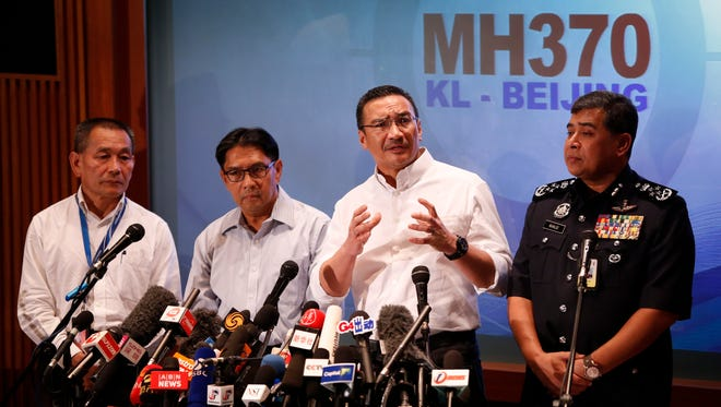 Malaysia's acting minister of transport Hishamuddin Hussein, second from right, speaks during a press conference with  Azharuddin Abdul Rahman, second from left, and Malaysia Airlines Group CEO Ahmad Jauhari Yahya, left, and Malaysia Inspector-General of Police Khalid Abu Bakar in Kuala Lumpur, Malaysia, on Sunday.