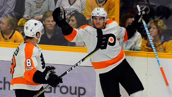 Travis Konecny, right, had one of five Flyers goals Tuesday night in their crushing loss to Nashville.