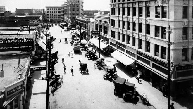 Looking South on Mesa from Mills. Roberts-Banner building right foreground (Blochs Millinery); S.H. Kress next; Elite Candies next, after shoe store.  Caples building shown before addition of stories in 1912. Rio Grande Valley Bank & Trust Co. (1 story building on right) and adjoining little Caples building. On left, Stag Bar, city National Bank, EP Optical Co. George D. Kendall, optician. Blumenthal's at end of street on right. Alexander collection. Popular is farthest sign on left side.