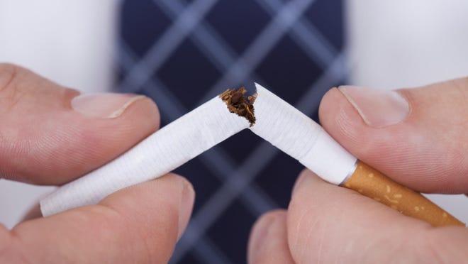 Man Hand Breaking Cigarette