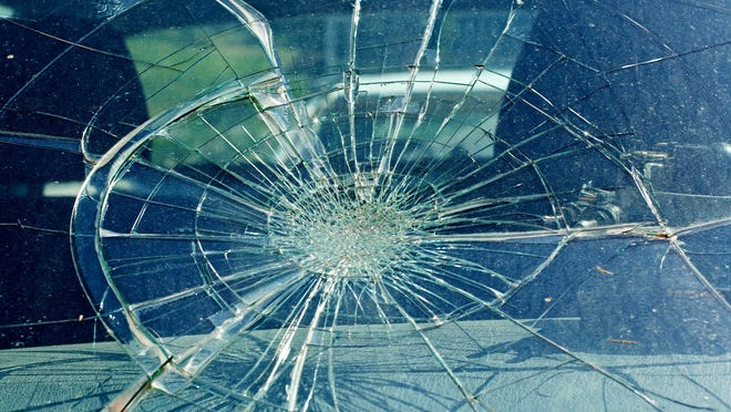 Broken windshield in the car accident