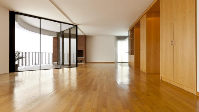 Solid wood flooring is the best deal for beauty and durability and is also the easiest to refinish, says columnist Prentiss Gray.