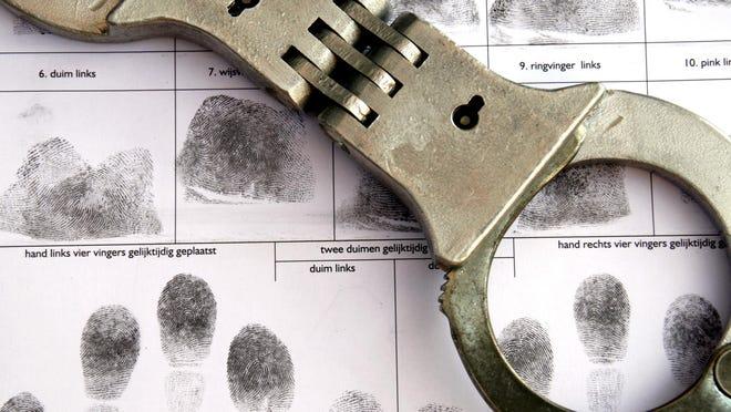 Handcuffs and fingerprints.