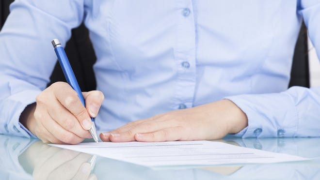 Businesswoman Signing On Paper