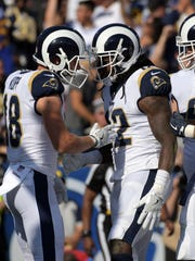 Rams receivers Cooper Kupp, left, and Sammy Watkins had big games in Sunday's home win over the Saints.
