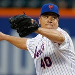 Mets starting pitcher Bartolo Colon delivers in the first inning of a baseball game against the Baltimore Orioles in New York, Tuesday, May 5, 2015.