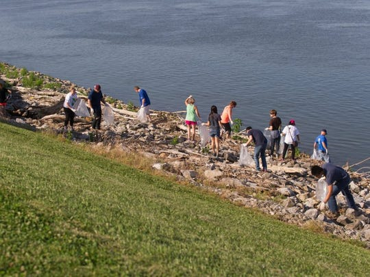 Volunteers collect trash at the 2016 Ohio River Sweep.