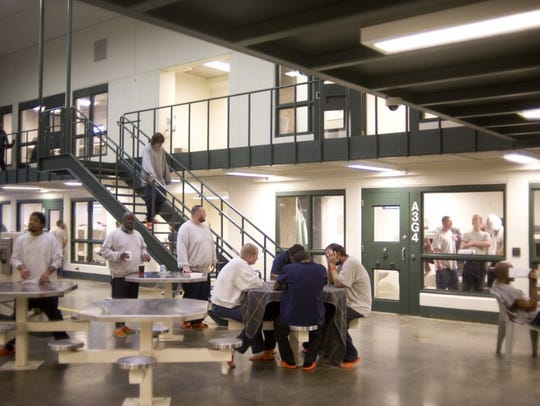 Photos by DENNY SIMMONS / COURIER & PRESS Inmates at