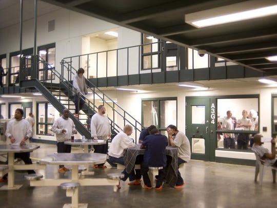 Photos by DENNY SIMMONS / COURIER & PRESS Inmates at the Vanderburgh County Jail spend their