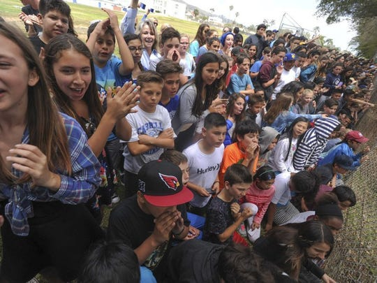 Students at Cabrillo Middle School cheer the cyclists in the Amgen Tour of California coming through Ventura in 2016.