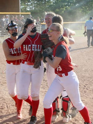 Members of the Pacelli softball team celebrate after earning a trip to the WIAA Division 4 state tournament in Madison with an 8-6 win over Cochrane-Fountain City on Thursday.