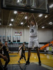 Johnny McCants and the Oñate High boys basketball enter