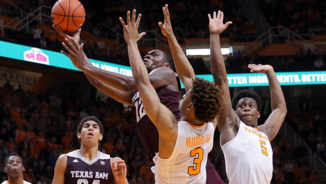 Texas A&M guard Jalen Jones (12) goes to the basket against Tennessee guard Robert Hubbs III (3) on Jan. 9, 2016.