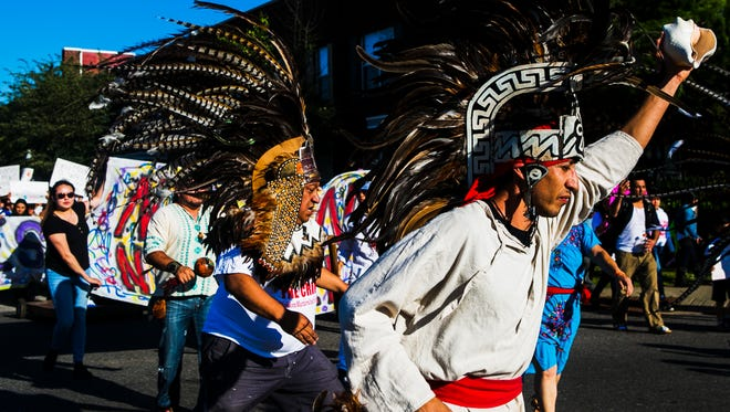 May 1, 2017 - Eduardo Tellez, left, and his brother Agustin Diaz, members of the group Danza Azteca Quetzalcoatl, lead the May 1 Immigration March from Clayborn Temple to the National Civil Rights Museum on Monday. The event was held to demonstrate that immigrants are significant contributors to the United States' economy and an important part of the country.