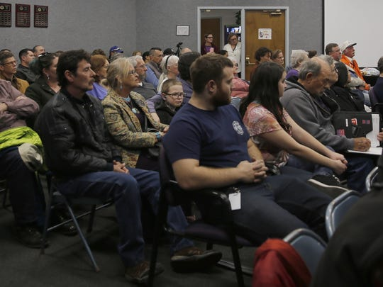 Aztec residents listen to candidates answer questions Thursday during a candidate forum at Aztec City Hall.